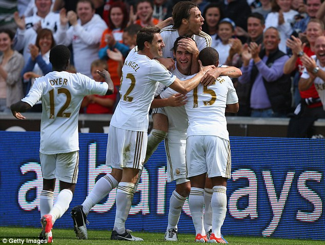 Flying: Swansea continued their impressive start to the season with a thumping 3-0 win over West Ham