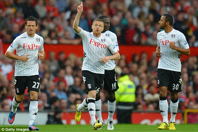 In front: Damien Duff of Fulham celebrates scoring the opening goal against Manchester United