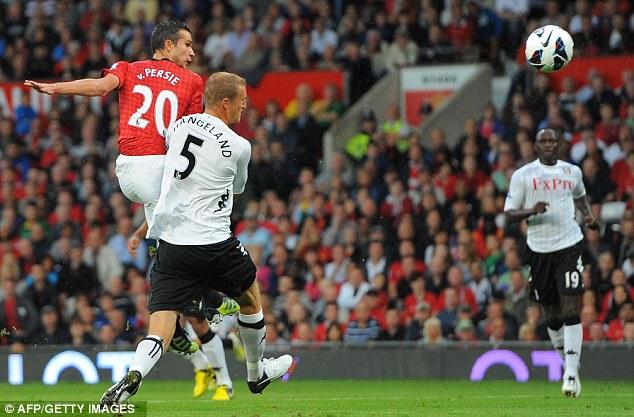 Level pegging: Robin van Persie scores United's equaliser before celebrating with his team-mates