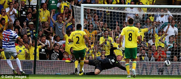Level: Bobby Zamora scores the rebound to level for QPR against Norwich