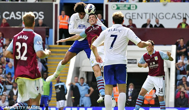 Easy does it: Everton's Marouane Fellaini (second left) scores their second goal against Aston Villa