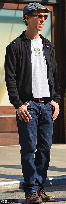 Disappearing act: The Magic Mike star kept his shrinking frame out of view in a white t-shirt, black fleece Members Only jacket, and blue jeans