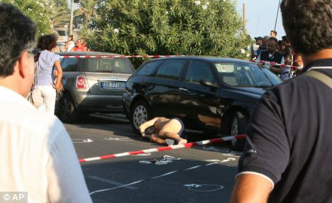 Murder scene: authorities are searching for the two men who shot and killed Marino, who was visiting the a beach while on holiday with his family on the Mediterranean coast