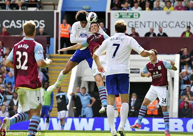 High riser: Fellaini scores heads home his goal