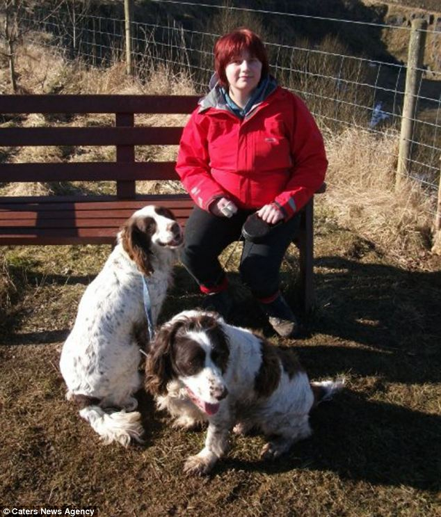 Shocking scene: Police said Edmonds' house looked like 'an abattoir' with blood everywhere. Her two dogs (pictured) were badly injured while she presented self-inflicted cuts, claiming an intruder had attacked the dogs and her
