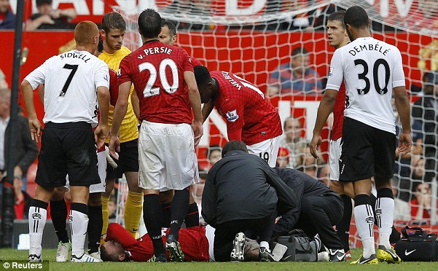 Down and out: Rooney hadn't been on the pitch all that long, but was forced off on a stretcher
