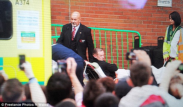 Hospitalised: Rooney is taken to the ambulance after suffering the injury