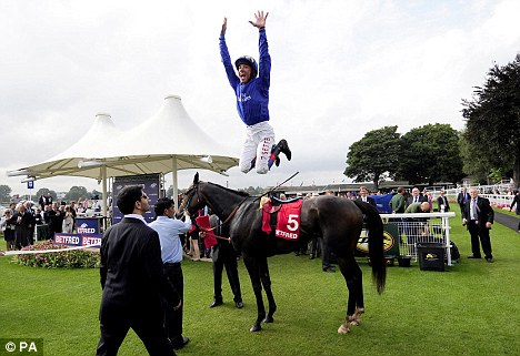 Tradition: Dettori celebrated with his customary flying dismount