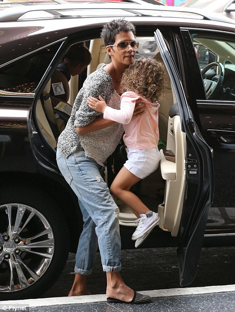 Getting a lift: Halle helped her daughter's friend out of the car