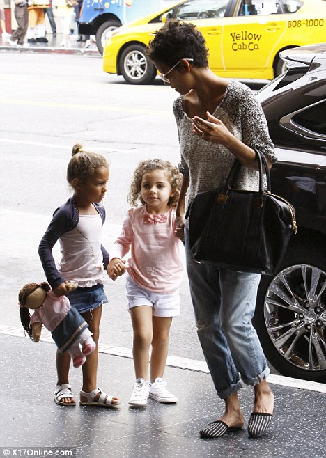 Girls day out: Halle and Nahla were joined by one of little girl's friends