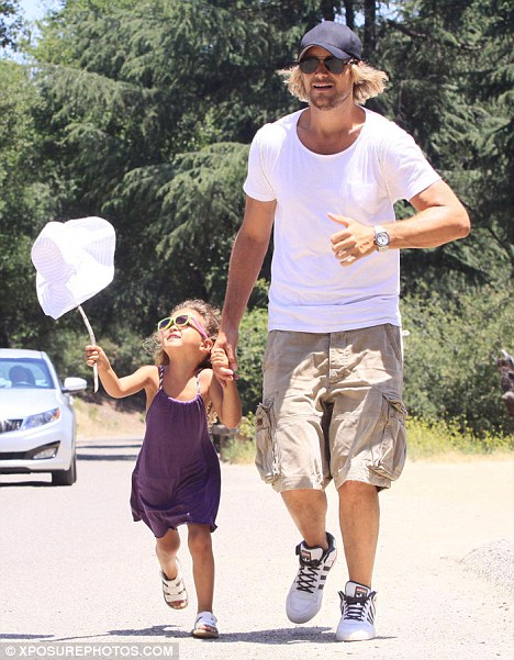 Fighting back: Gabriel Aubry, pictured with daughter Nahla in May is insisting his child remain in the U.S.