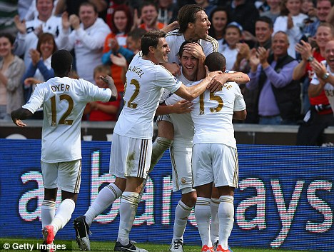 Flying: Swansea continued their impressive start to the season on Saturday