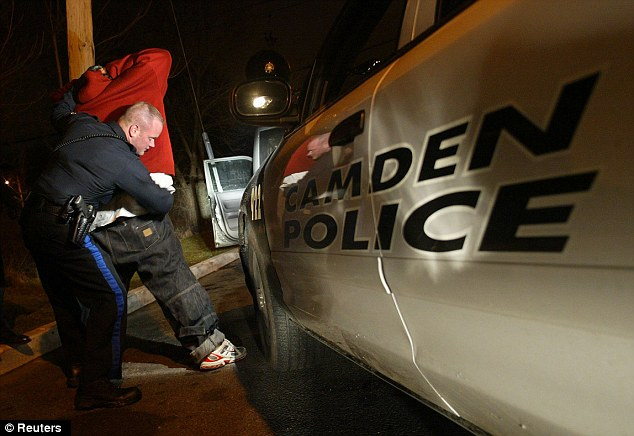Gone: Camden police officers will lose their jobs at the end of the year when the department is disbanded