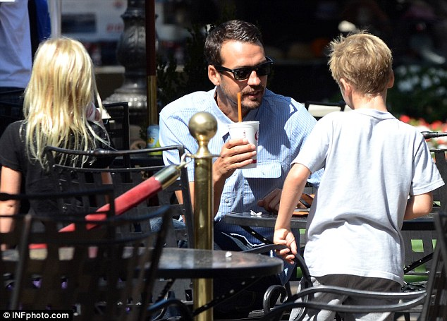Thirsty work: The trio stopped for a Jamba Juice