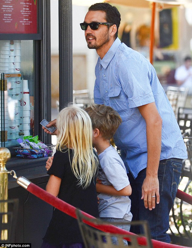 Dad on duty: Rupert Sanders took his two children Skyla and Tennyson for a shopping trip to the Grove in Los Angeles, California, over the weekend