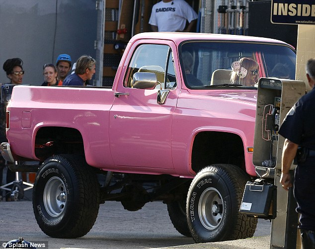 This is how I roll: Christina got behind the wheel of a dolly pink pick-up truck