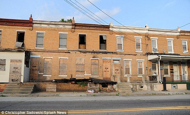 A row of desolate houses once home to prosperity now stand empty and broken after the fortunes of the city turned