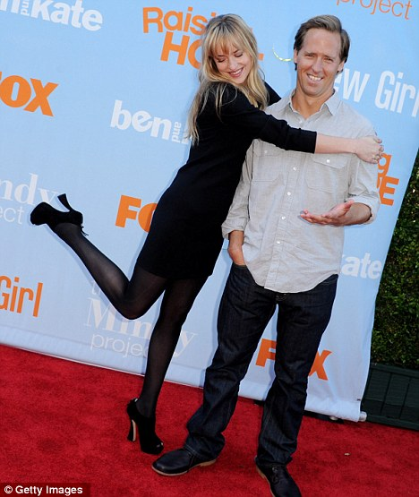 Chemistry? Dakota poses with Nat Faxon, who plays Ben in the show
