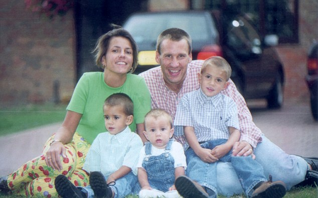 The couple at their home in Saint Albans in happier times with sons Charlie, Ben and Sam who are now teenagers