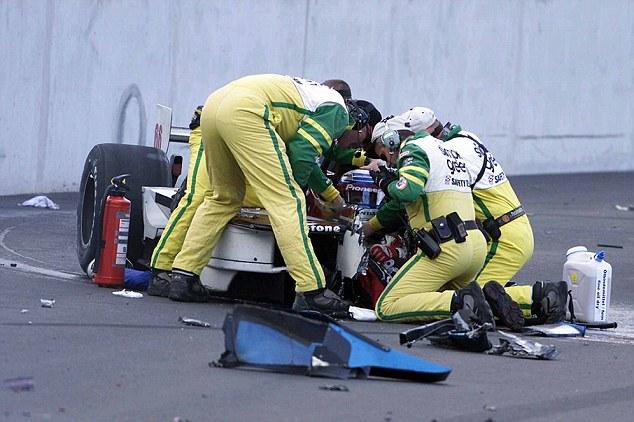 Treatment: Zanardi is helped after the crash