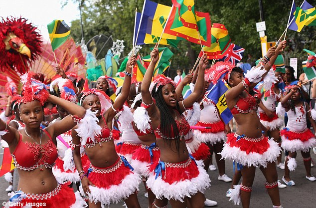 Revellers perform on the colourful family day at the Notting Hill Carnival this Bank Holiday