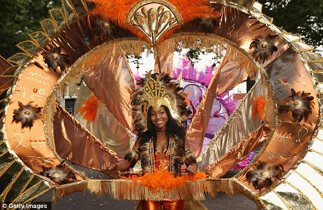 Another picture from the Notting Hill carnival shows another reveller dressed in an elaborate outfit