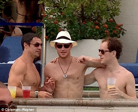 Controversial: Prince Harry (centre) relaxes in a Las Vegas swimming pool on the holiday during which he was photographed naked. The Sun published the pictures despite a request to respect the prince's privacy