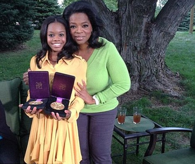 Gabby Douglas poses with Oprah Winfrey and her two gold medals during a taping of Oprah's Next Chapter on Saturday