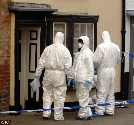 Hunting for evidence: Police forensic officers at work at a crime scene in Faversham, Kent (file picture)