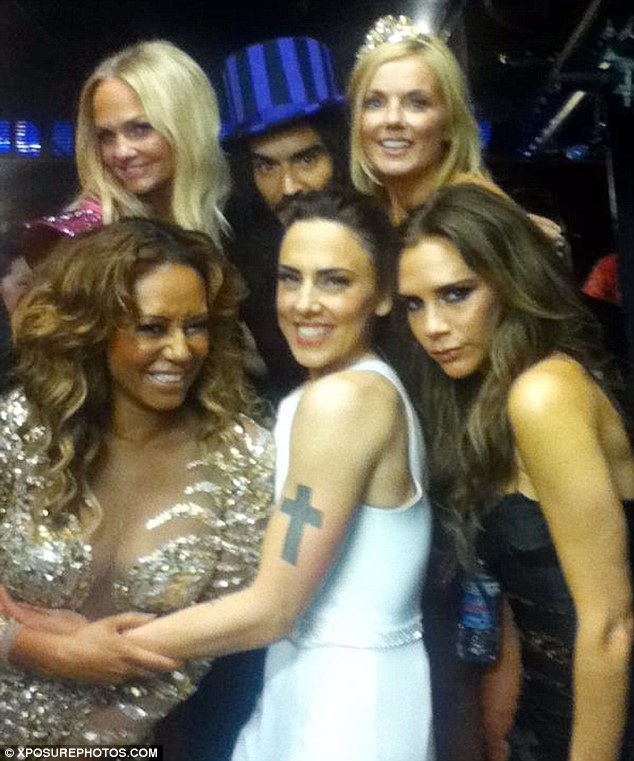 Hitting it off: Russell admitted he had a crush on Geri after posing for this photo with the Spice Girls backstage at the Olympics