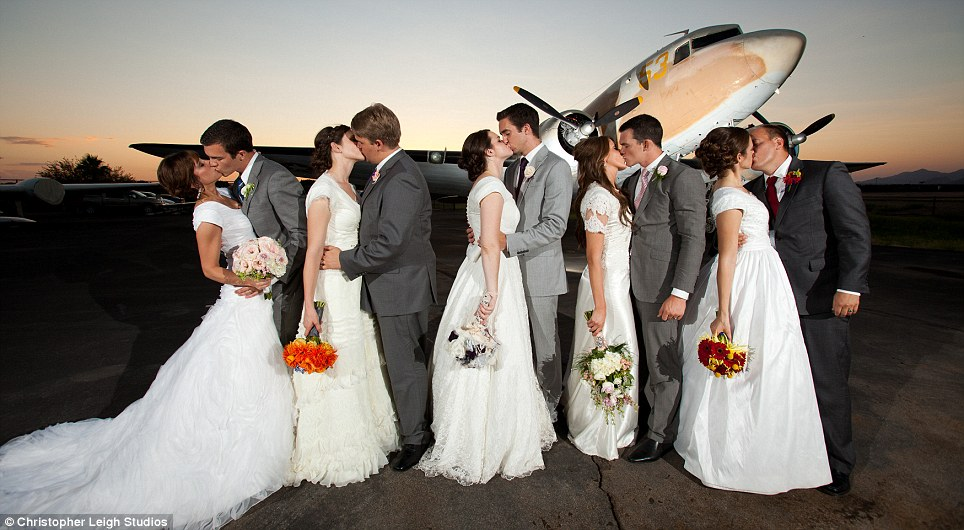 Big love: The Waldie siblings kiss their other halves at the airplane museum in Mesa, Arizona -which was large enough to fit their 1,200 wedding guests