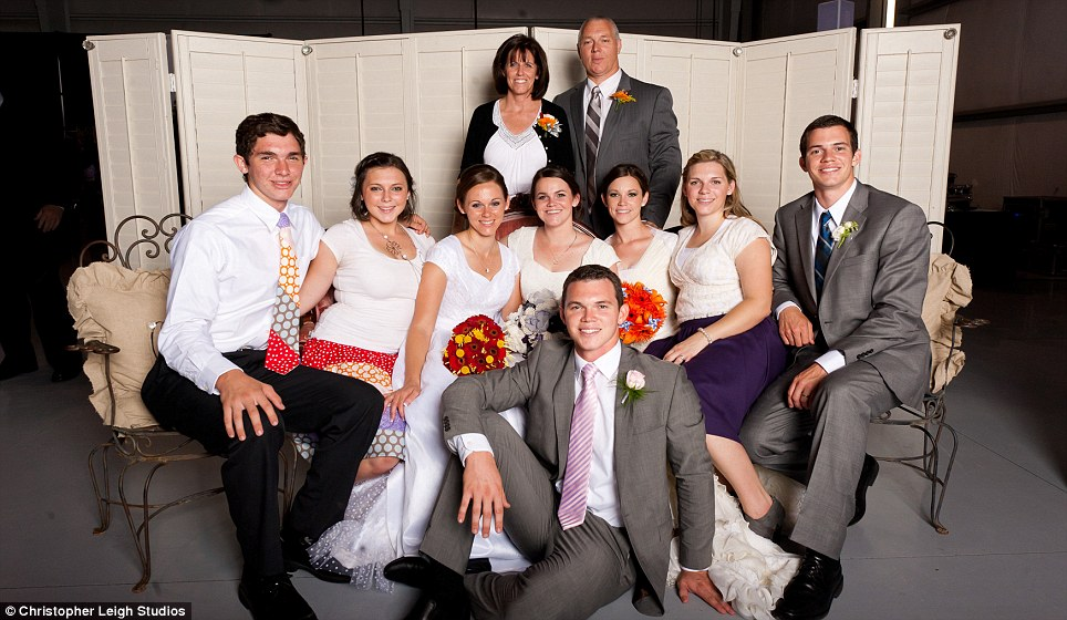Keeping it in the family: Father Doug Waldie (back right with wife Kristen) has said that his eight children (pictured, including the three not getting married) always do everything together