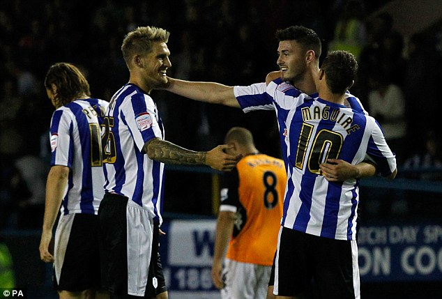 Cup of shocks: Gary Madine scoring his penalty to give Sheffield Wednesday the lead