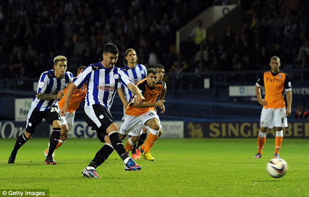 Spot on: Madine scores his penalty