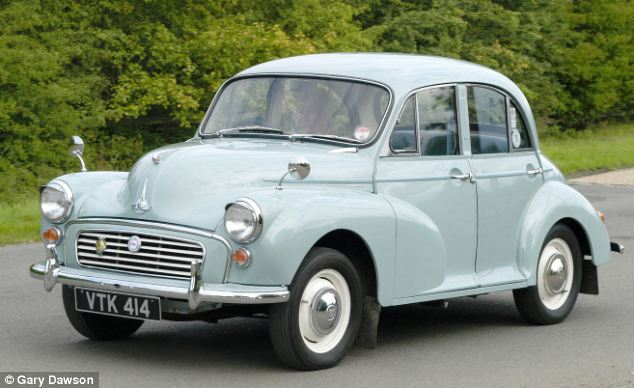 A classic 1957 Morris Minor is displayed at a car show, the iconic car won the eight spot in the Autocar poll