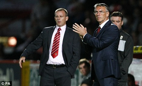 Taking the matter seriously: Nigel Adkins (right)