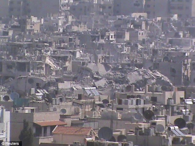 Far from 'better': A general view of damaged buildings in Juret al-Shayah in Homs. The city has been destroyed by fighting, and similarly intense battles are now raging in Damascus and Aleppo