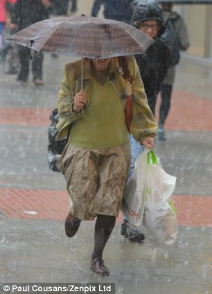 Pics Paul Cousans........ WEATHER..Rain.rain.rain Torreniall downpour in Manchester city centre catches out shoppers more dressed for Summer