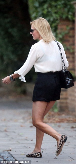 Date day? Geri was spotted leaving her London home in a stunning monochrome ensemble yesterday afternoon
