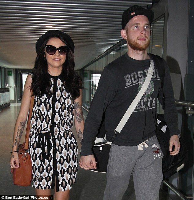 Leaving on a jet plane: Cher and her fiancé Craig Monk arrived at Heathrow airport on Tuesday to catch their flight to the U.S.