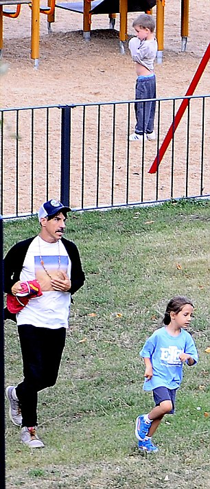 Actively engaged: Kiedis ran around the park with Everly, before standing closely by to assist the youngster