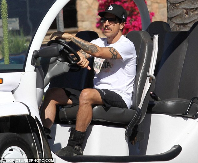 Easy access: Kiedis was last week driving around Malibu in his custom-built electric car, his foot bandaged