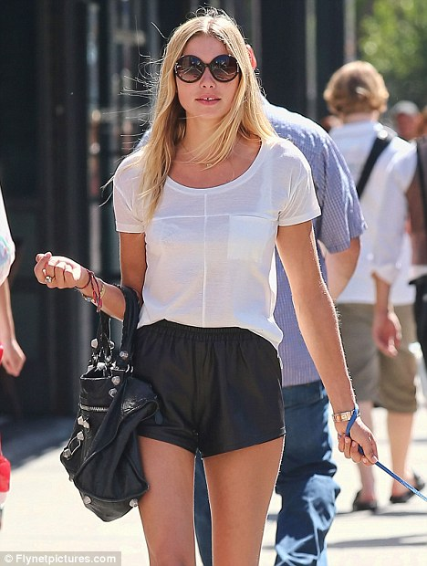 Showcasing her skills: Model Jessica Hart was pictured yesterday (Wednesday) taking her dog for a walk in New York