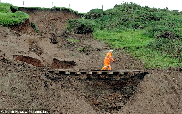 The torrential rain caused the cliff face to collapse and washed away the natural inferastructure