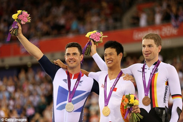 Podium: Silver medalist Mark Colbourne poses on the podium with gold medallist Zhangyu Li of China and bronze medalist Tobias Graf of Germany