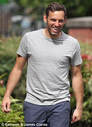 Feeling good: Richard Wright arrives for his medical with Manchester City on Thursday