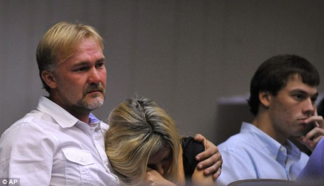 Struggle: Wesley Thomas comforts his wife Brenda Thomas during the hearing of Pvt. Isaac Aguigui