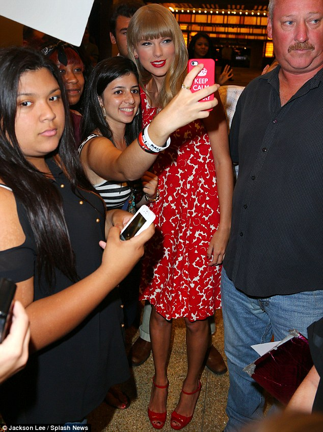 Teen idol: Swift cheerfully posed for another candid snap