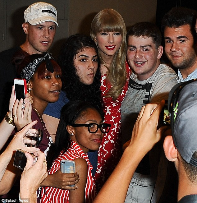 Making their day: The 22-year-old smiled as she posed for photos with eager fans