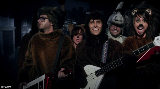 Monkeying around: Swift's band members played up the whimsical theme by dressing up as furry animals